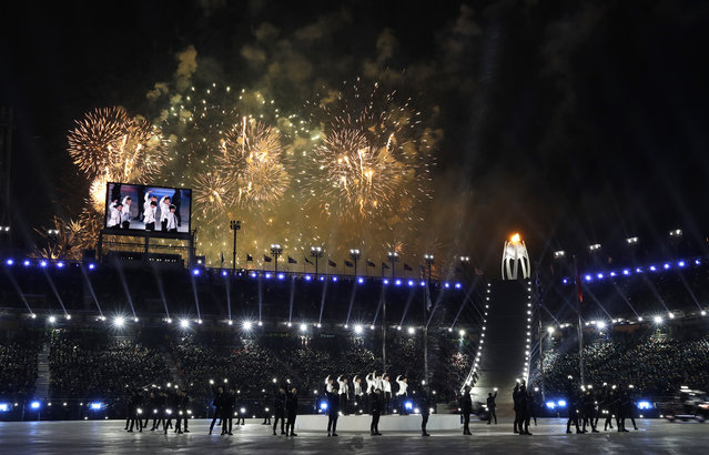 Fireworks explode as EXO performs during the closing ceremony of the 2018 Winter Olympics in Pyeongchang, South Korea, Sunday, February 25, 2018. (Photo by Natacha Pisarenko/AP Photo)
