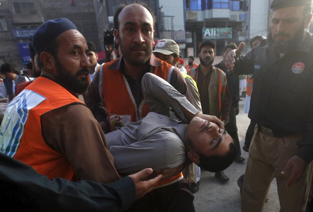 Rescue workers carry a man, who was injured during an earthquake, at the Lady Reading hospital, Peshawar, Pakistan, October 26, 2015. (Photo by Fayaz Aziz/Reuters)