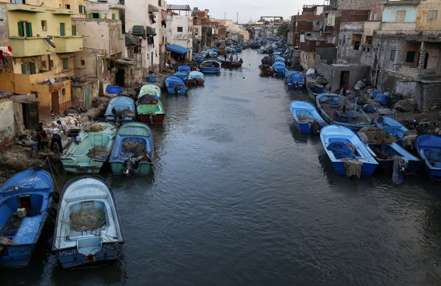 Boats are seen moored in front of houses in the fishermen's village in El Max in the Mediterranean city of Alexandria October 18, 2014. (Photo by Amr Abdallah Dalsh/Reuters)