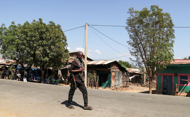 A member of the Amhara Special Force patrols a street in Soroka village in Amhara region near a border with Tigray, Ethiopia on November 9, 2020. (Photo by Tiksa Negeri/Reuters)