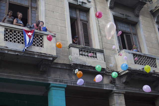 People release balloons during the annual procession of Our Lady of Charity, the patron saint of Cuba, on the streets of downtown Havana September 8, 2014. (Photo by Alexandre Meneghini/Reuters)