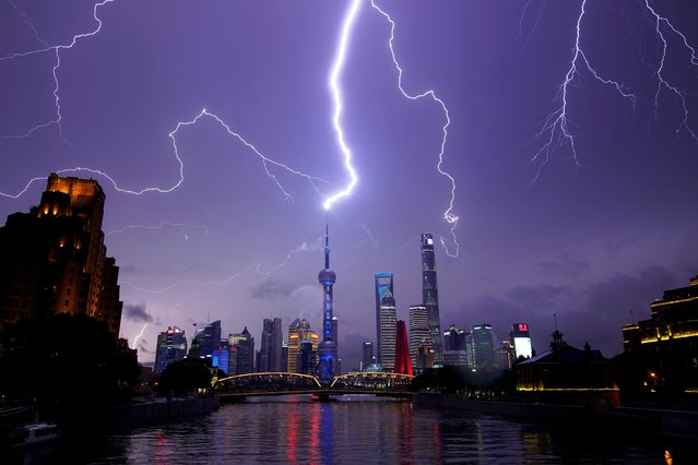 Lightning strikes are seen above the skyline of Shanghai's financial district of Pudong, China on August 10, 2020. (Photo by Aly Song/Reuters)