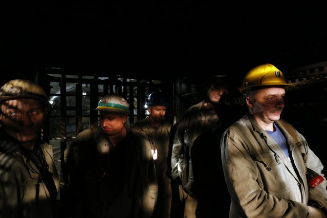 Miners leave from the mine with elevator during their last working day at Hungary's last hard coal deep-cast mine at Markushegy on December 23, 2014. (Photo by Laszlo Balogh/Reuters)