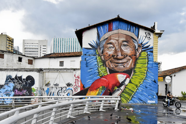 Graffiti in downtown Cali, Colombia on January 9, 2016. Considered vandalism in the past, graffiti is enjoying a boom in Colombia, where it is has even been promoted in authorized places and where visitors can take private tours to see giant murals in the cities. Street art reflects the desire for peace in Colombia, while the government and the FARC guerrillas negotiate an end to the country' s half- century armed conflict. (Photo by Luis Robayo/AFP Photo)