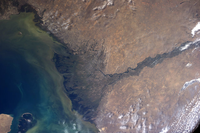 A photograph of the Tibetan plateaus, (Himalayas) taken on board the International Space Station. (Photo by NASA/SPL/Barcroft Media)
