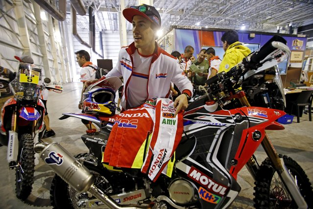 Spain's Joan Barreda Bort arrives with his Honda for the technical verification exercise ahead of the Dakar Rally 2015 in Buenos Aires January 2, 2015. (Photo by Jean-Paul Pelissier/Reuters)