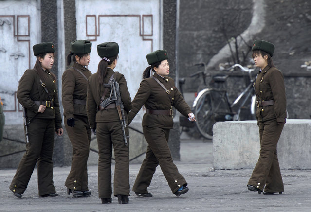 In this Thursday, April 11, 2013 photo, North Korean female soldiers perform marching exercise on the river bank of the North Korean town of Sinuiju, opposite to the Chinese border city of Dandong. (Photo by AP Photo)