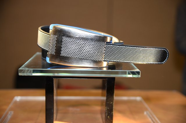 Belty, a smart belt from Paris-based Emiota, is displayed at CES Unveiled, the opening event for the media preview days at the 2015 Consumer Electronics Show, January 4, 2015 in Las Vegas, Nevada.  Belty, the worlds first connected belt, monitors the wearers waistline measurements and advises when it is time to lose weight. Belty will also automatically loosen when the wearer sits and tighten when the wearer stands. (Photo by Robyn Beck/AFP Photo)