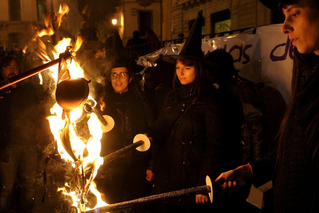 Women of the Plataforma Feminista de Asturias (Feminist Platform of Asturias) burn bras at the end of a demonstration commemorating the International Day for the Elimination of Violence Against Women, in Oviedo, northern Spain, November 25, 2015. (Photo by Eloy Alonso/Reuters)