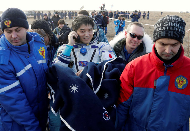 Russian space agency rescue team members carry International Space Station (ISS) crew member Takuya Onishi of Japan shortly after the landing of the Russian Soyuz MS space capsule near the town of Dzhezkazgan (Zhezkazgan), Kazakhstan, October 30, 2016. (Photo by Dmitri Lovetsky/Reuters)