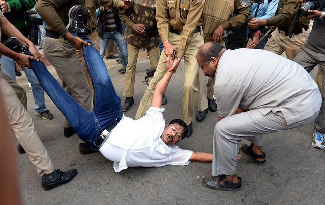 Indian security personnel detain activists of the Indian Youth Congress who were shouting slogans against the Narendra Modi-led National Democratic Alliance (NDA) government during a protest against intolerence in New Delhi on November 30, 2015. (Photo by Prakash Singh/AFP Photo)