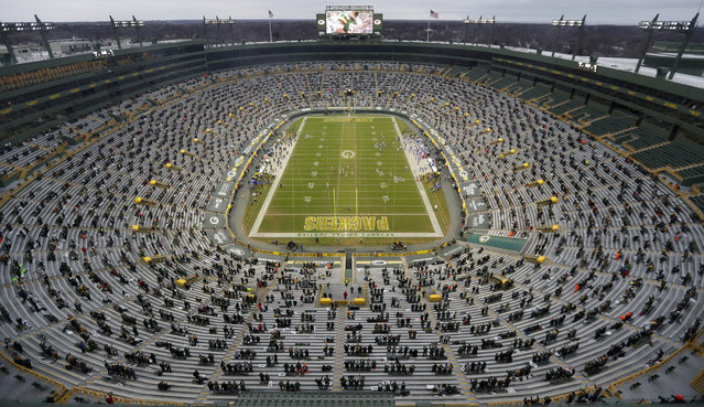 About 8,000 fans attend the Green Bay Packers' playoff against the Los Angeles Rams at Lambeau Field in Wisconsin on January 16, 2021. Because of the coronavirus pandemic, this was the first time during the 2020 season that any season ticket holders were able to attend a game at this venue. (Photo by Sarah Kloepping/USA Today Sports)