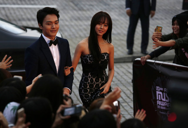 South Korean actor Yeo Jin-goo and actress Kim So-hyun walk on the red carpet during 2015 Mnet Asian Music Awards (MAMA) in Hong Kong, China December 2, 2015. (Photo by Bobby Yip/Reuters)