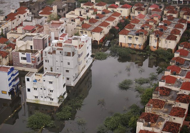 An aerial view shows a flooded residential colony in Chennai, India, December 6, 2015. (Photo by Anindito Mukherjee/Reuters)