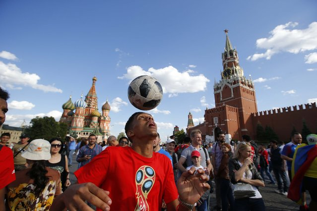 Morocco soccer fan plays with the ball at the Red Square after the matchgroup B match between Portugal and Morocco at the 2018 soccer World Cup at the Luzhniki Stadium in Moscow, Russia, Wednesday, June 20, 2018. (Photo by Sergei Karpukhin/Reuters)