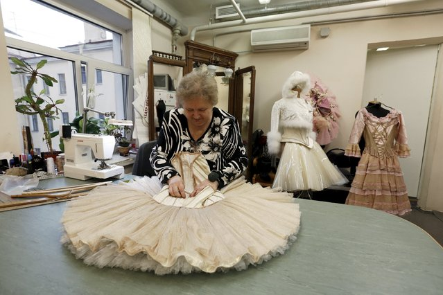 """A seamstress prepares a costume for Nacho Duato's ballet """"The Nutcracker"""" at the Mikhailovsky Theatre in St. Petersburg, Russia November 19, 2015. (Photo by Grigory Dukor/Reuters)"""