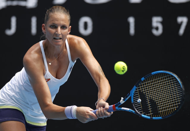 Karolina Pliskova of the Czech Republic makes a backhand return to United States' Danielle Collins during their second round match at the Australian Open tennis championship in Melbourne, Australia, Thursday, February 11, 2021. (Photo by Rick Rycroft/AP Photo)