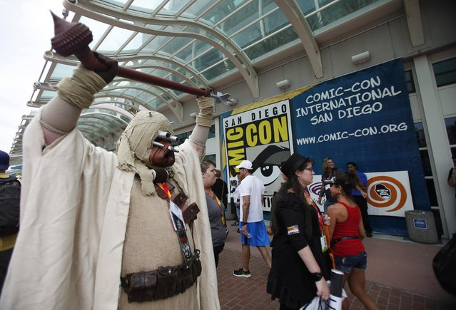 An attendee dressed as a Tusken Raider from the movie series Star Wars poses during Comic-Con international convention in San Diego, California July 13, 2012. (Photo by Mario Anzuoni/Reuters)