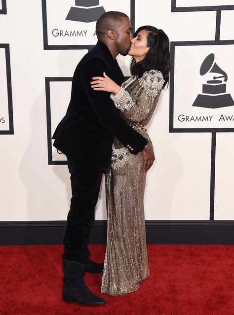Kanye West, left, and Kim Kardashian arrive at the 57th annual Grammy Awards at the Staples Center on Sunday, February 8, 2015, in Los Angeles. (Photo by Jordan Strauss/Invision/AP Photo)