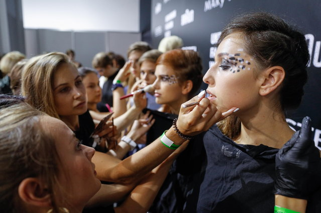 Models get their makeup backstage during the Ukrainian Fashion Week in Kiev, Ukraine, 01 September 2018. (Photo by Sergey Dolzhenko/EPA/EFE)