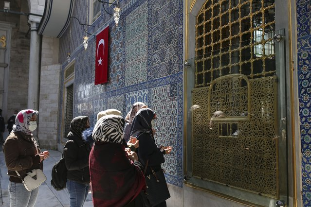 Women offer their prayers at the Eyup Sultan Mosque, in Istanbul, Monday, April 12, 2021, a day before Ramadan. Turkey's President Recep Tayyip Erdogan was forced to announce renewed restrictions following a spike on COVID-19 cases, such as weekend lockdowns and the closure of cafes and restaurants during Ramadan, the holy Muslim month, starting on April 13. (Photo by Emrah Gurel/AP Photo)