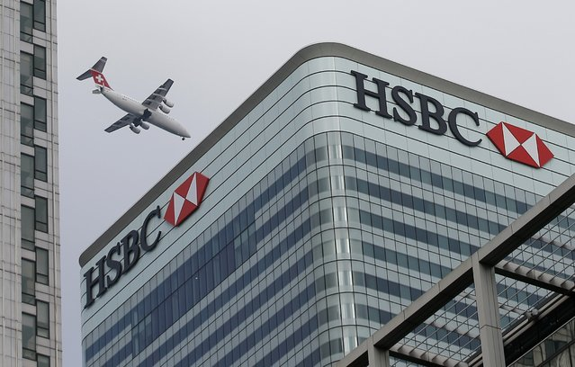 A Swiss International aircraft flies past the HSBC headquarters building in the Canary Wharf financial district in east London February 15, 2015. (Photo by Peter Nicholls/Reuters)