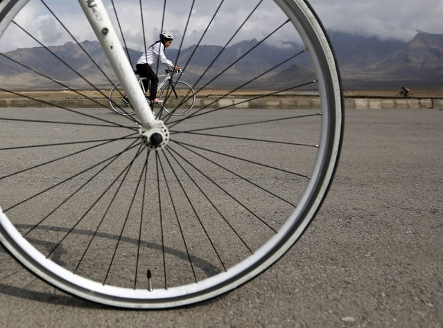 Zhala, a member of Afghanistan's Women's National Cycling Team exercises on the outskirts of Kabul February 20, 2015. (Photo by Mohammad Ismail/Reuters)