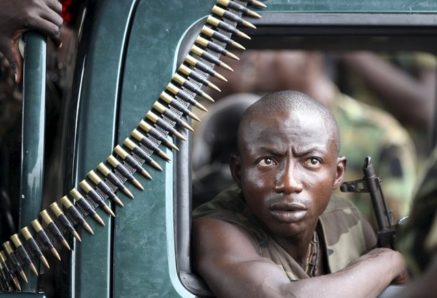 A pro-Ouattara soldier of FRCI (Republican forces of Ivory coast) sits with bullet rounds in Yopougon April 29, 2011. (Photo by Luc Gnago/Reuters)