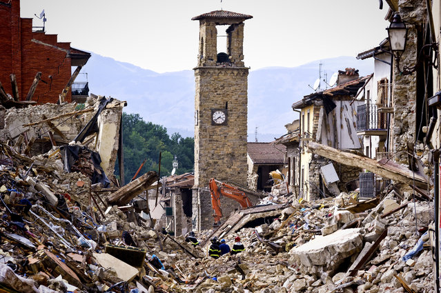 Firefighters continue removing rubble near the bell tower in Amatrice,  central Italy on August 30, 2016 Italy. Italy was struck by a powerful, 6.2-magnitude earthquake in the night of August 24, 2016, which has killed at least 293 people and devastated dozens of houses in the Lazio village of Pescara del Tronto, Accumoli and Amatrice. (Photo by Stefano Montesi/Corbis via Getty Images)