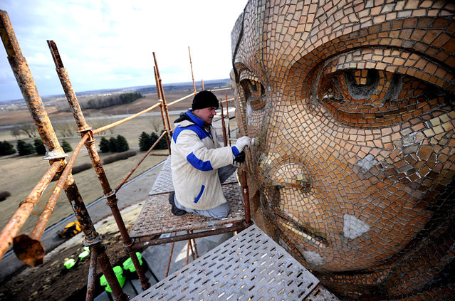 A worker renovates the Mound of Glory memorial complex honoring Soviet soldiers who fought during World War II in the village of Sloboda, some 25 kilometers east of Minsk, on April 3, 2015. Belarus will mark the 70th anniversary of the end of WWII on May 9, 2015. (Photo by Sergei Gapon/AFP Photo)