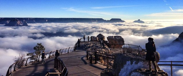 A rare total cloud inversion is pictured at Mather Point on the South Rim of the Grand Canyon National Park in Grand Canyon, Arizona in this November 29, 2013, picture provided by the National Park Service on December 3, 2013. Cloud inversions are formed through the interaction of warm and cold air masses. (Photo by Erin Whittaker/National Park Service)