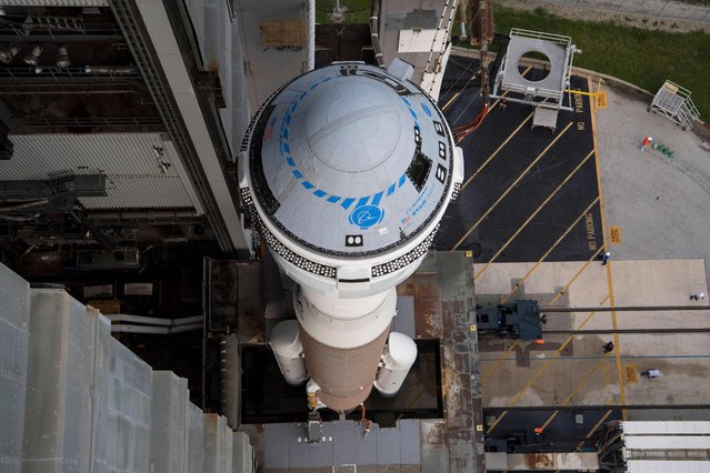 This NASA photo shows a United Launch Alliance Atlas V rocket with Boeing's CST-100 Starliner spacecraft aboard as it is rolled out of the Vertical Integration Facility to the launch pad at Space Launch Complex 41 ahead of the Orbital Flight Test-2 (OFT-2) mission, on August 2, 2021 at Cape Canaveral Space Force Station in Florida. Boeing's Orbital Flight Test-2 will be Starliner's second uncrewed flight test and will dock to the International Space Station as part of NASA's Commercial Crew Program. The mission, currently targeted for launch at 1:20 p.m. EDT on August 3,2021 will serve as an end-to-end test of the system's capabilities. (Photo by Aubrey Gemignani/NASA via AFP Photo)