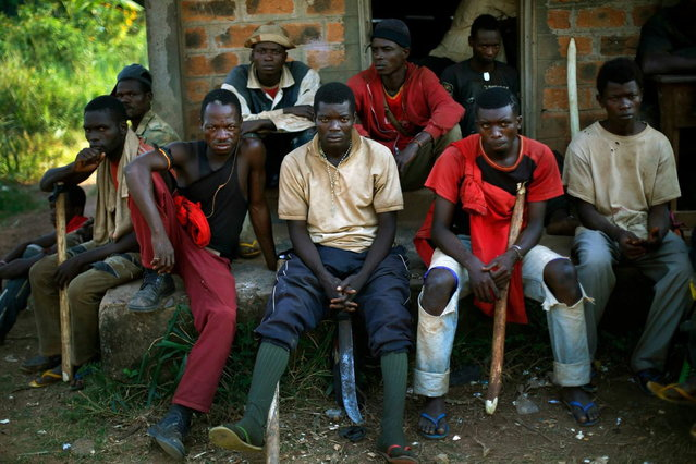 Former FARCA (Central African Republic Forces) soldiers linked to Anti-Balaka Christian militiamen who have set camp in a school in the Boeing neighborhood of the Central African Republic's capital Bangui pose Sunday December 15, 2013. (Photo by Jerome Delay/AP Photo)