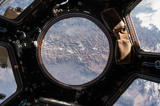 "The Earth view from the cupola onboard the International Space Station. NASA astronaut Scott Kelly tweeted this image with a comment on May 14, 2015: ""My first look out the window today"". (Photo by Scott Kelly/NASA)"