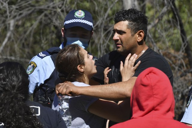 Anthony Elfalak, right, and his wife, Kelly, embrace after hearing their son AJ is found alive on the family property near Putty, north west of Sydney, Australia, Monday, September 6, 2021. Three-year-old AJ was found sitting in a creek and cupping water in his hands to drink three days after he was lost in rugged Australian woodland. (Photo by Dean Lewins/AAP Image via AP Photo)