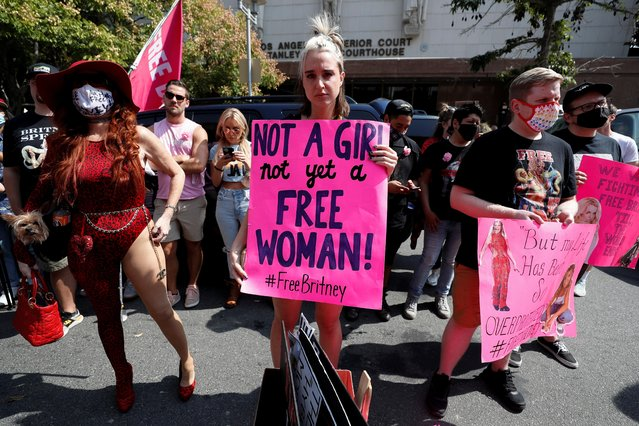 Supporters of pop star Britney Spears hold signs as they gather on the day of a conservatorship case hearing at Stanley Mosk Courthouse in Los Angeles, California, U.S., September 29, 2021. (Photo by Mario Anzuoni/Reuters)