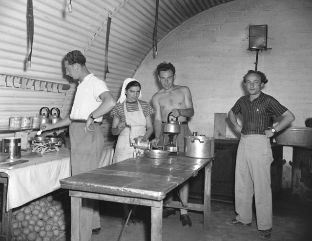Four Jewish immigrants, the cooking staff for food prepared for the camp's babies, work in one of kitchens at Caraolos Camp on the island of Cyprus in the Mediterranean Sea on May 14, 1948. The camp is one of three Jewish immigrant camps on the island. Refugees have their own camp director who is assisted by a board of 10 other refugees. (Photo by Frank Noel/AP Photo)