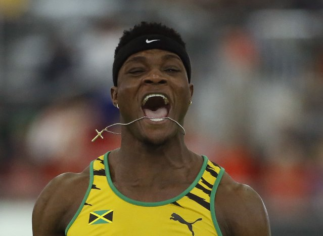 Omar McLeod of Jamaica reacts after he won the men's 60 meters hurdles final during the IAAF World Indoor Athletics Championships in Portland, Oregon March 20, 2016. (Photo by Lucy Nicholson/Reuters)