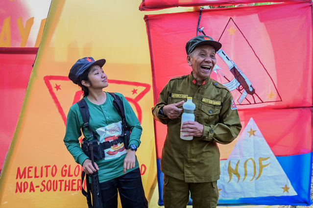 "Jaime ""Ka Diego"" Padilla (R), spokesperson of the Melito Glor Command of the New People's Army (NPA), and Ka Kathryn (Comrade Kathryn) (L) react during their 50th founding anniversary celebration at an undisclosed location in the mountains of Sierra Madre, Philippines, 31 March 2019. (Photo by Alecs Ongcal/EPA/EFE)"