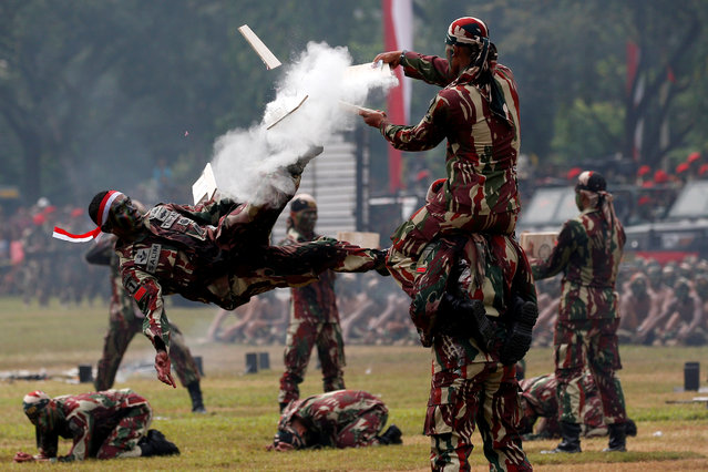 An Indonesian army special forces soldiers perform martial arts during celebrations for the 67th anniversary of the Indonesian Army Special Forces in Jakarta, Indonesia, April 24, 2019. (Photo by Willy Kurniawan/Reuters)