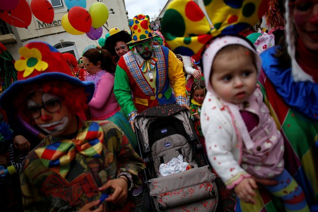 Carnival revellers participate in the clowns parade in Sesimbra village, Portugal, February 27, 2017. (Photo by Pedro Nunes/Reuters)