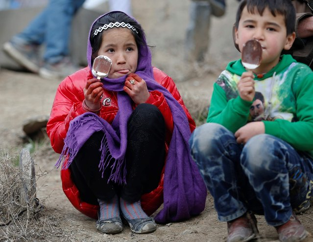 Afghan children have ice cream during the Afghan New Year (Newroz) celebration in Kabul March 21, 2014. (Photo by Ahmad Masood/Reuters)