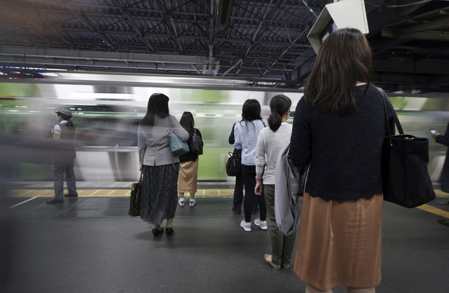 Commuters wait to get on a train at a station Wednesday, May 22, 2019, in Tokyo. A police-developed smartphone app with anti-s*x crime alarms has won massive subscriptions as Japanese women try to arm themselves against gropers on packed rush-hour trains. (Photo by Eugene Hoshiko/AP Photo)