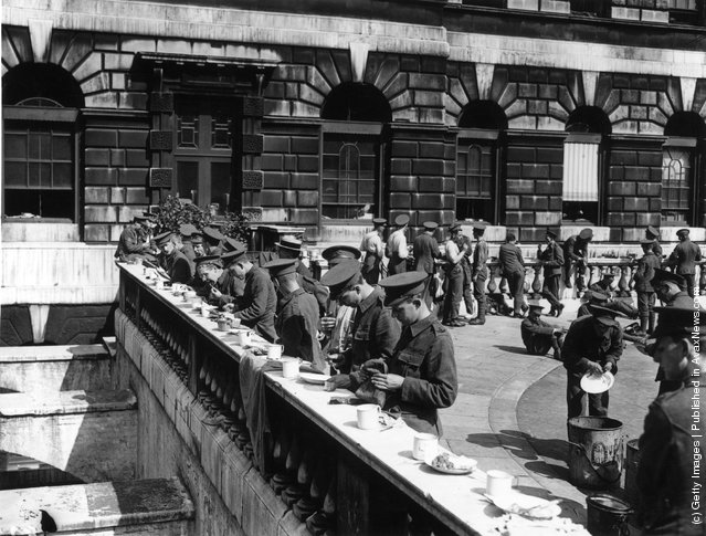 1914: Members of the Territorial army having a meal outside Somerset House, London
