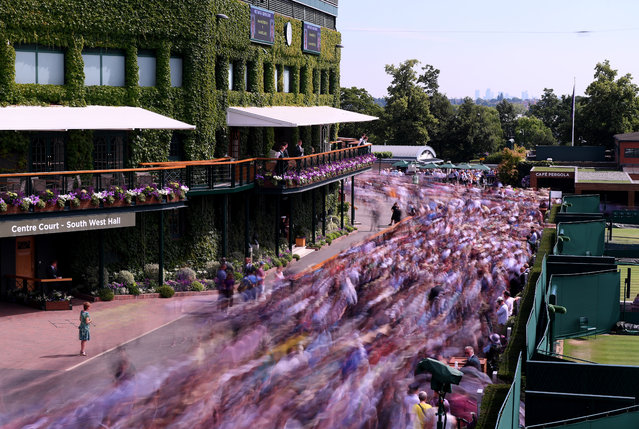 Fans enter the grounds ahead of Day 6 of The Championships – Wimbledon 2019 at All England Lawn Tennis and Croquet Club on July 06, 2019 in London, England. (Photo by Laurence Griffiths/Getty Images)
