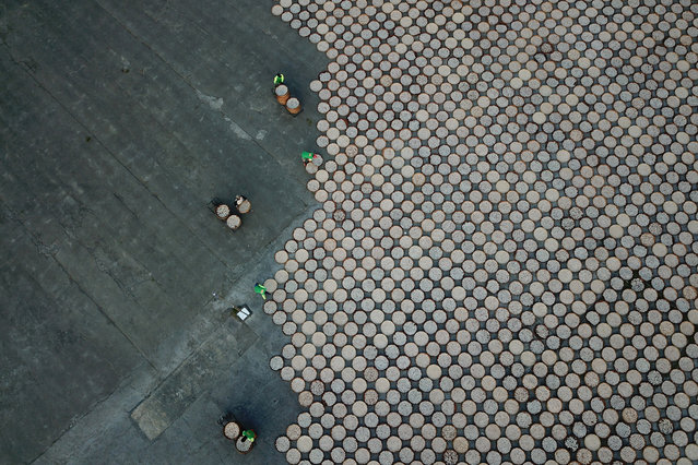 Workers arrange crackers for a drying proccess in Indramayu, West Java provinnce, Indonesia, June 17, 2019 in this photo taken by Antara Foto. (Photo by Dedhez Anggara/Antara Foto via Reuters)