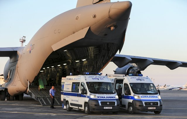 Tunisian ambulances bring seriously injured British nationals to a Royal Air Force C17 aircraft at Monastir airport in Tunisia, in this June 29, 2015 handout photograph released by Britain's Ministry of Defence in London on June 30, 2015. (Photo by Neil Bryden/Reuters/MoD Crown Copyright)