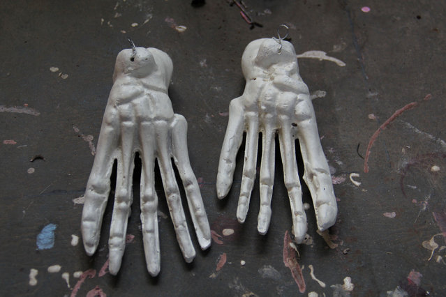 Props human hand bones are displayed on April 23, 2014 in Depok, West Java, Indonesia. The mannequins are made from fiberglass and will be used in schools, hospitals and laboratories. (Photo by Nurcholis Anhari Lubis/Getty Images)