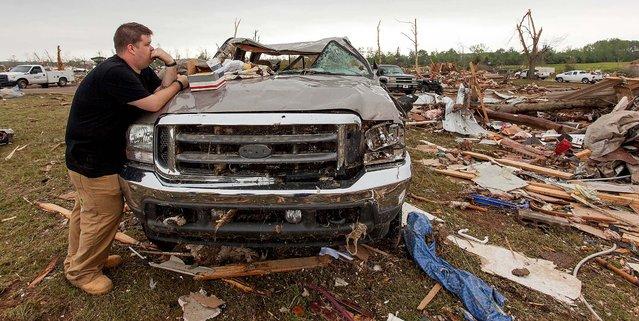 Nicholas Lee surveys the damage at his parents home off Cemetery Street in Vilonia, Arkansas on Monday. (Photo by Karen E. Segrave/Associated Press)
