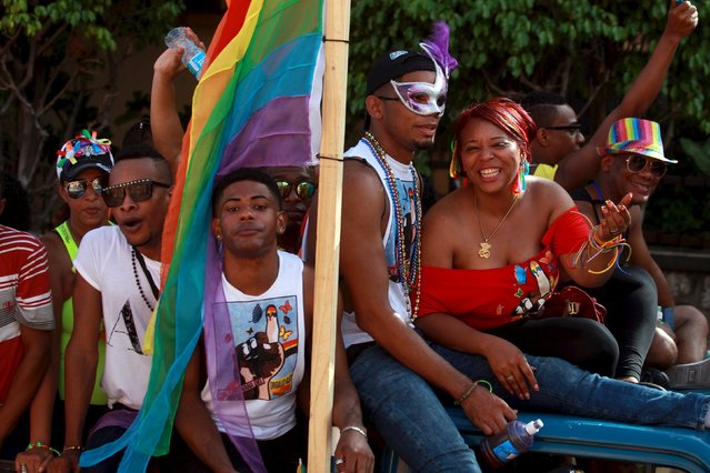 Revellers take part in a gay pride parade in Santo Domingo in the Dominican Republic July 5, 2015. (Photo by Ricardo Rojas/Reuters)